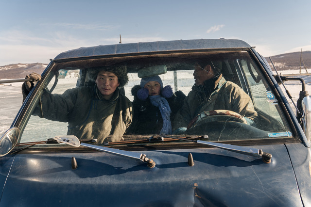 Spotlight Awards 2019 - Travel Photography Category Winning Image: A nomadic family in a pickup truck at Khövsgöl Lake in Northern Mongolia. gallery